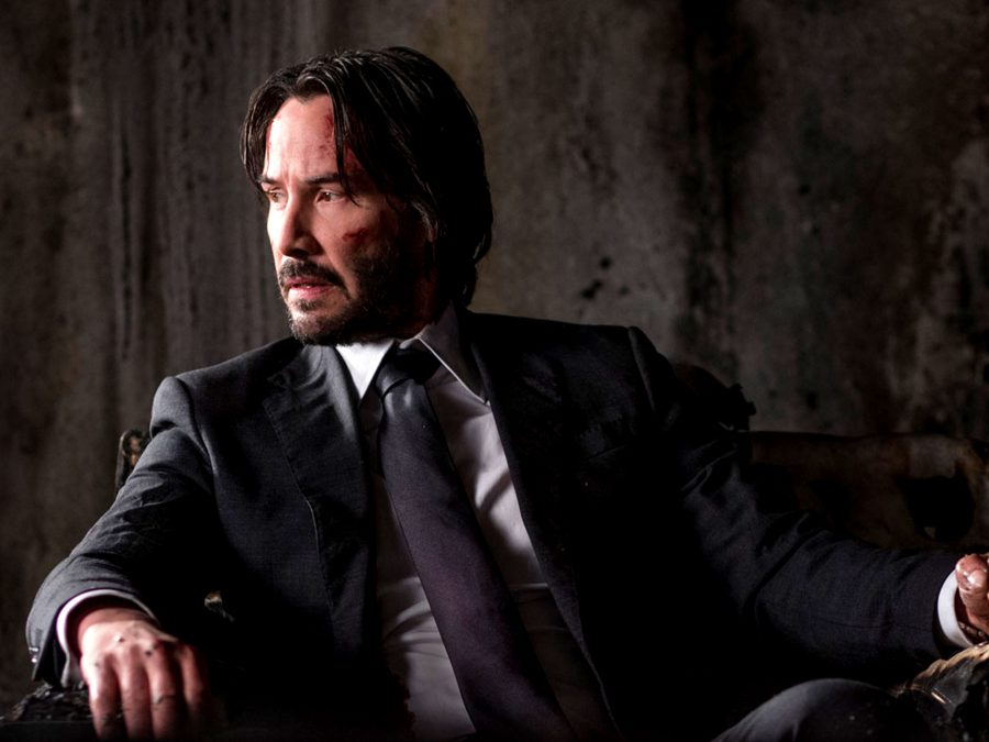 651636dc0b6 In cinema, the suit is commonly the uniform of the white-collar worker. The  opening scene, in which we see John Wick ...