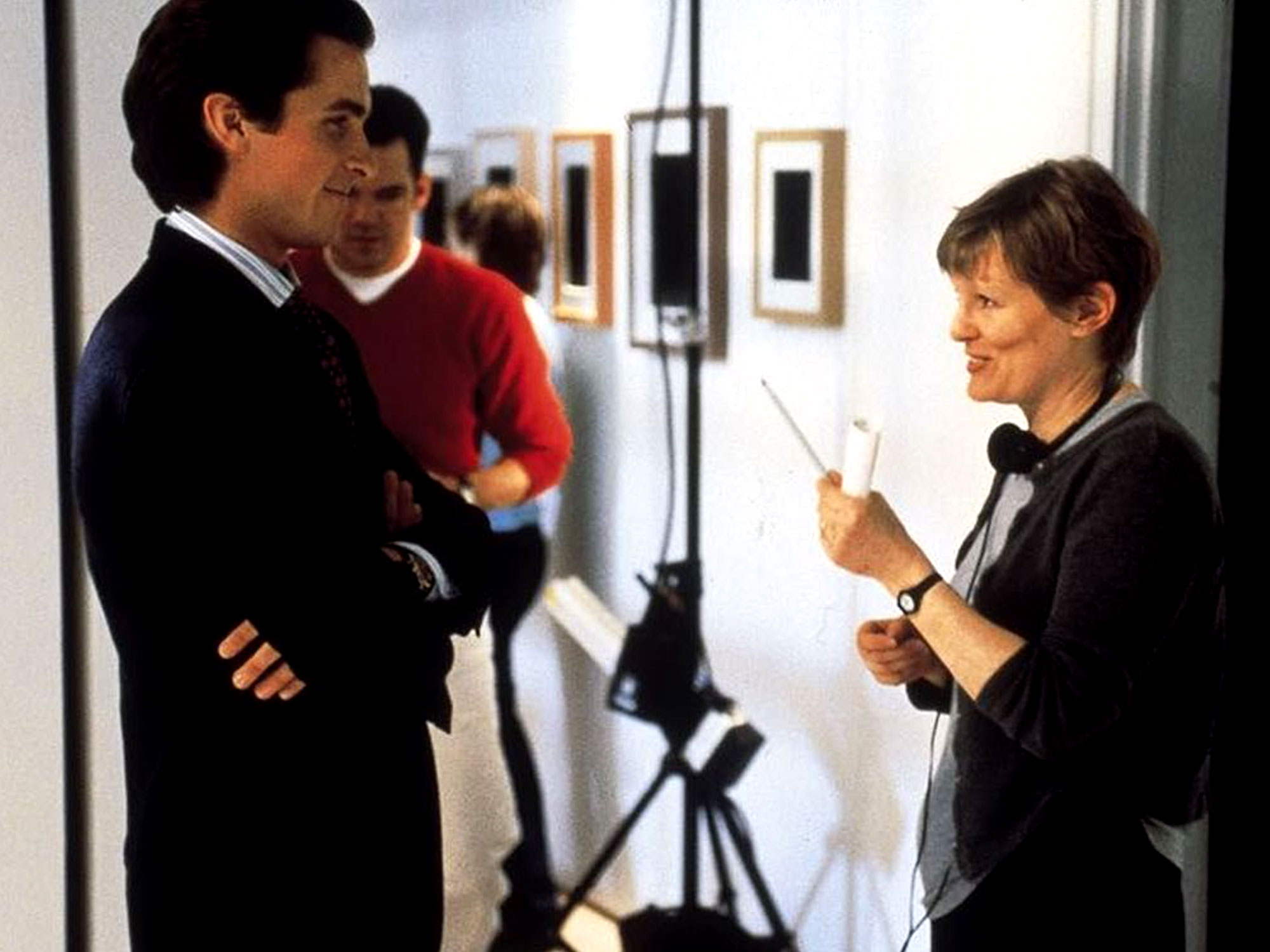 Mary Harron and Christian Bale on the set of American Psycho (2000)