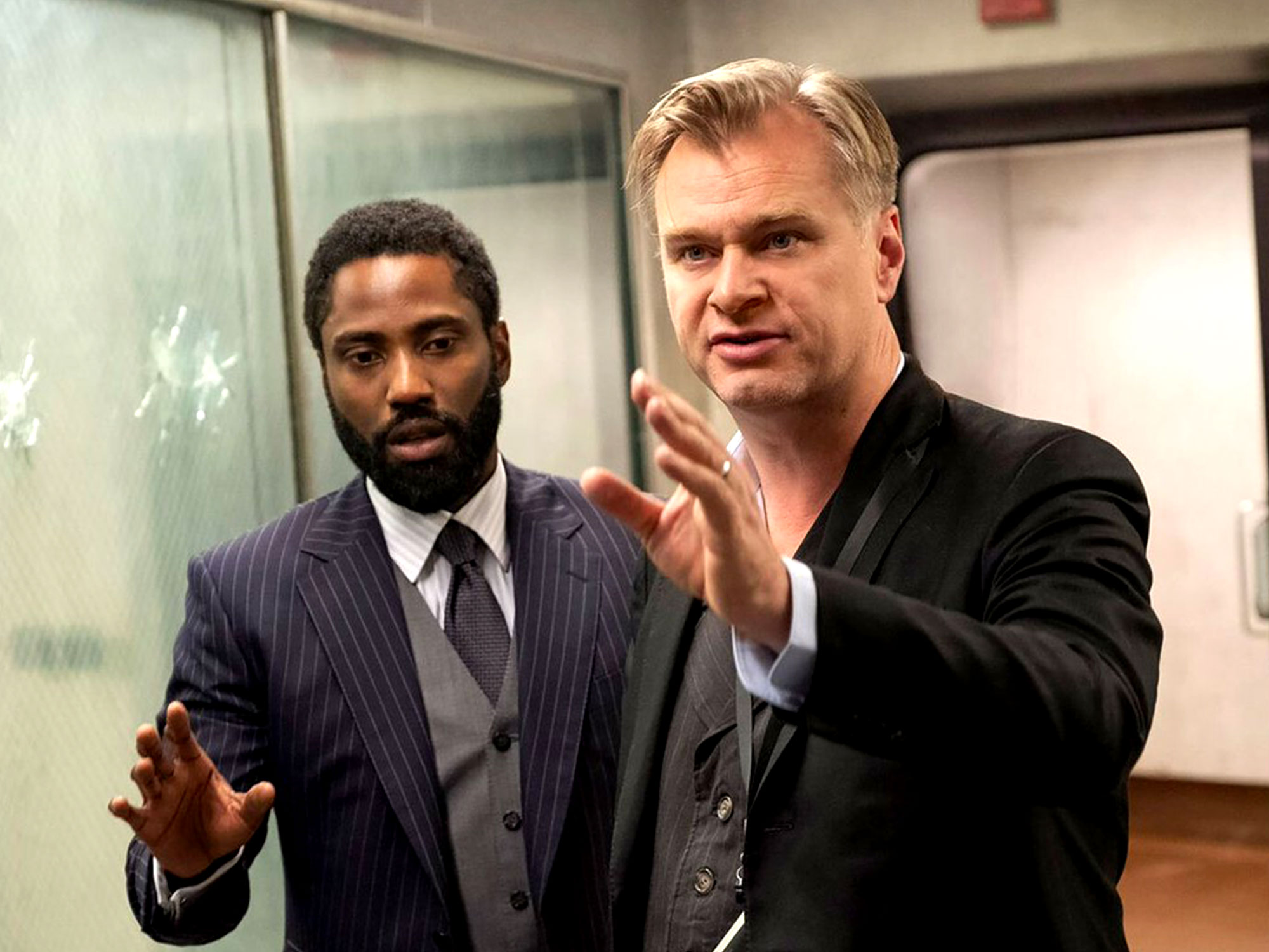 Christopher Nolan and John David Washington on the set of Tenet (2020)