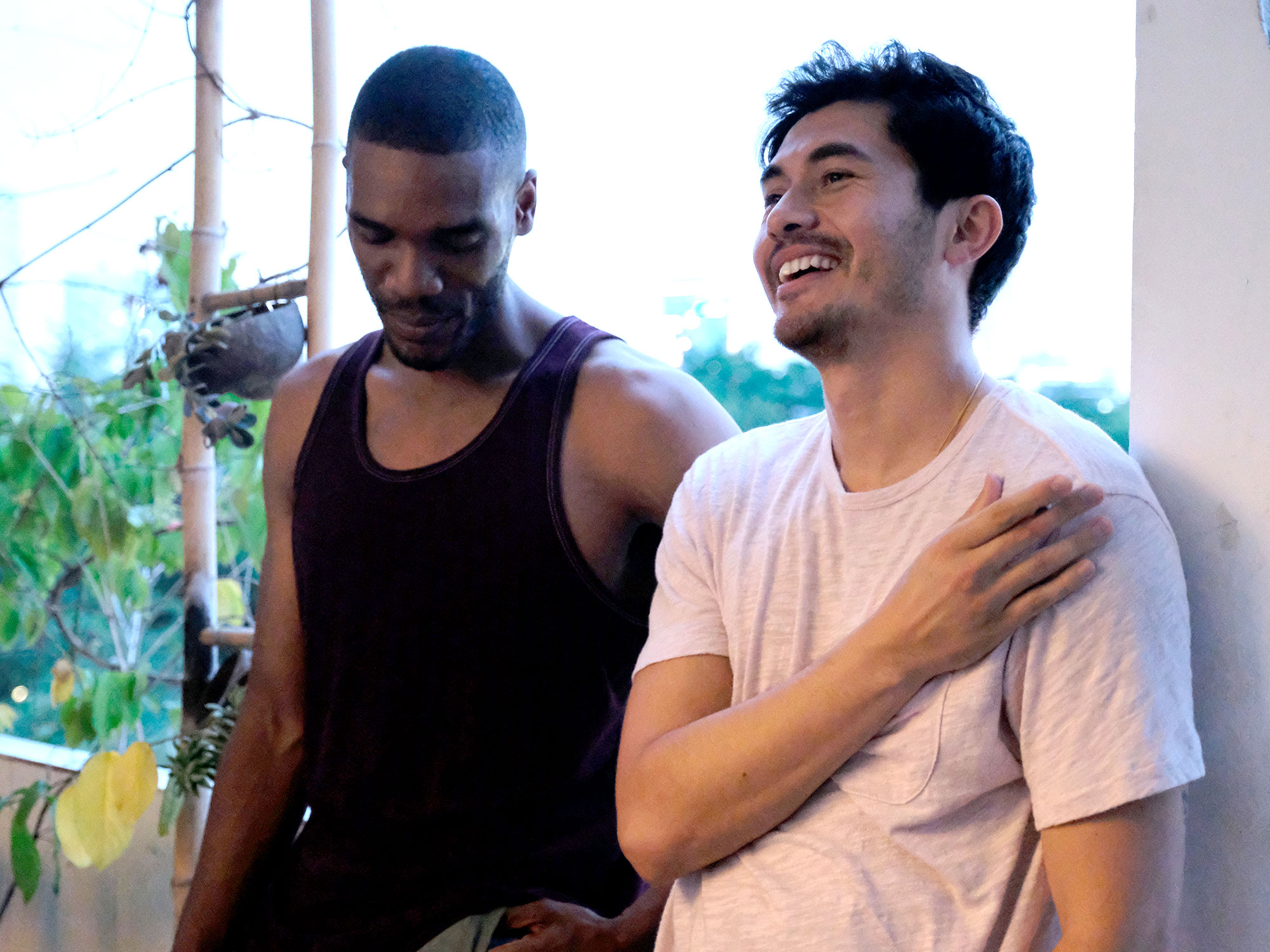 Henry Golding and Parker Sawyers in Monsoon (2020)